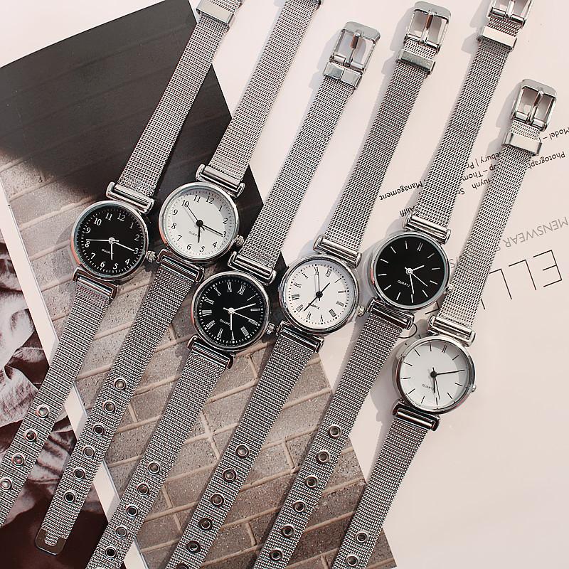 Đồng hồ nữ mặt trắng và đen