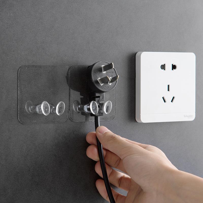 Móc dán tường cắm điện trong suốt